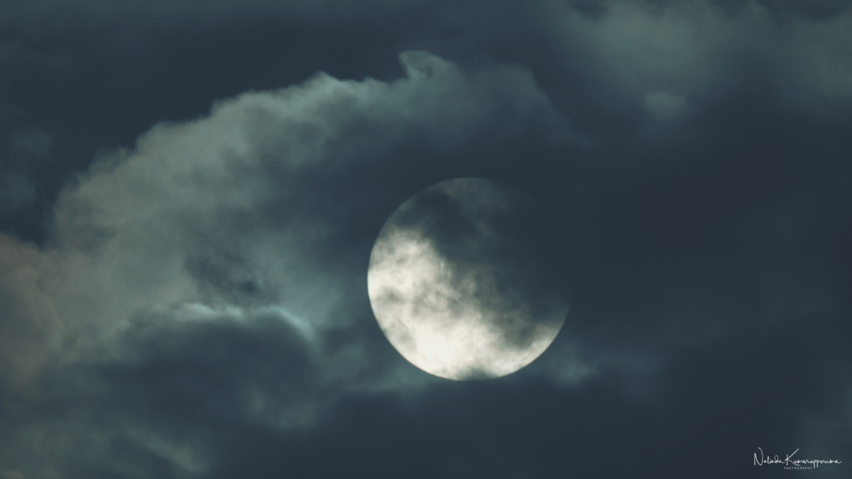 Full moon through theclouds